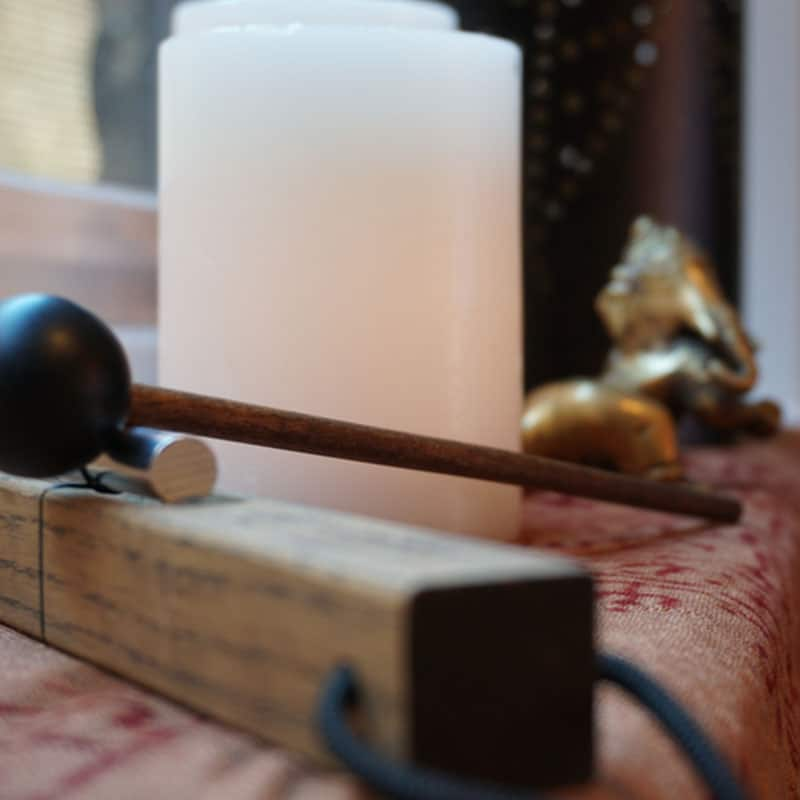 Photo of alter in the yoga studio with candles and accessories