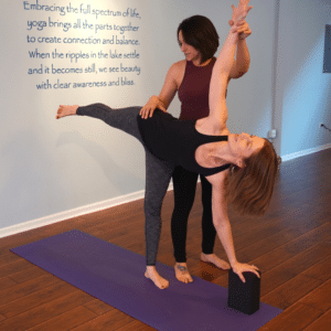 Yoga student in private session with yoga instructor